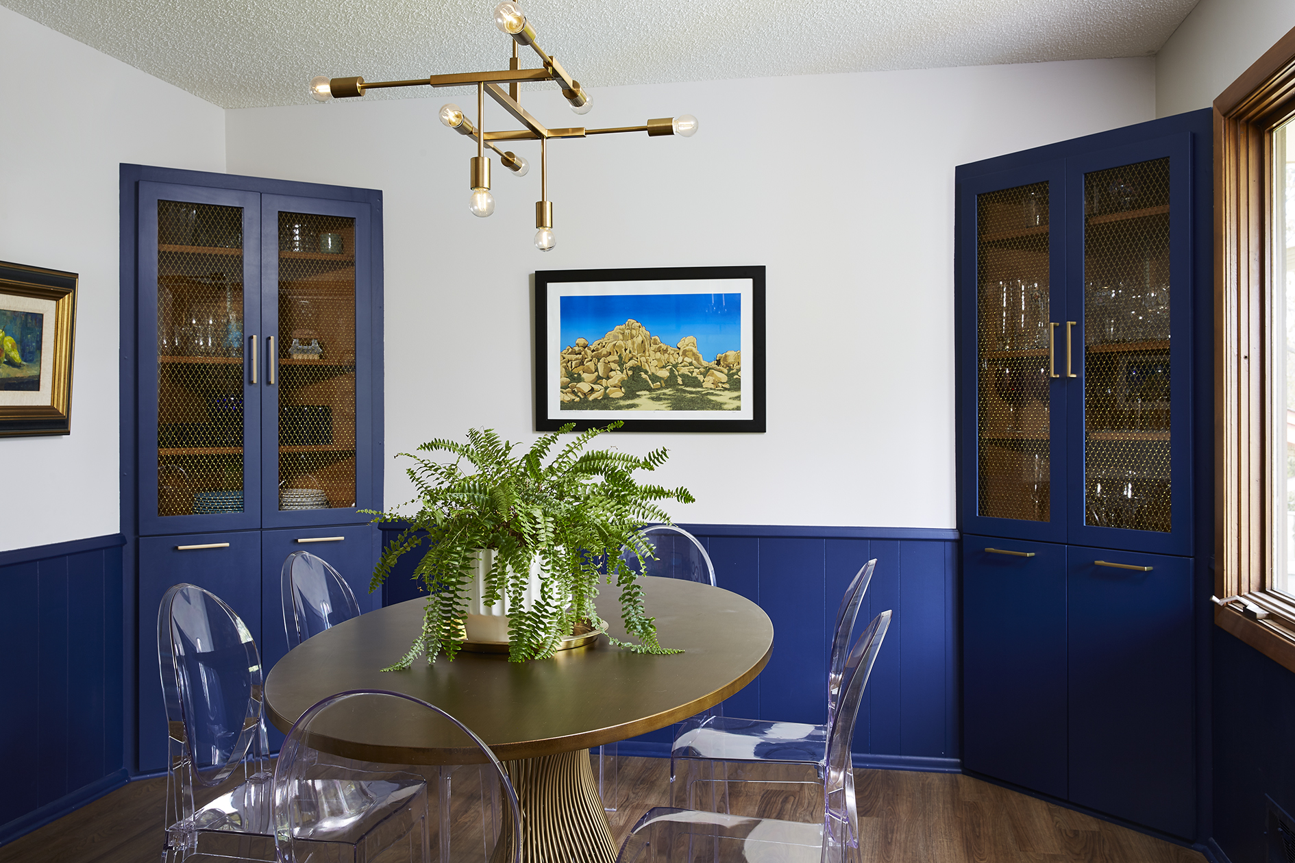 Mid century modern navy blue and brass dining room